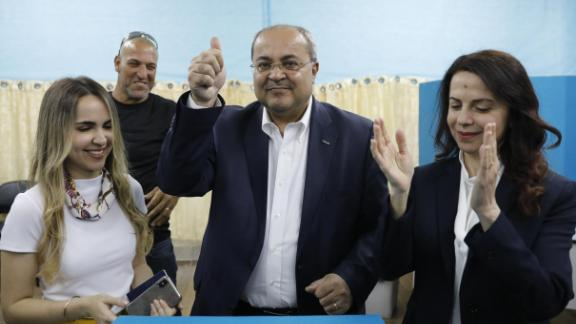 Israeli Arab politician Ahmed Tibi stands between his daughter (L) and wife as he casts his vote during Israel's parliamentary elections on April 9, 2019 in in the northern Israeli town of Taiyiba. - Israelis voted today in a high-stakes election that will decide whether to extend Prime Minister Benjamin Netanyahu's long right-wing tenure despite corruption allegations or to replace him with an ex-military chief new to politics. (Photo by Ahmad GHARABLI / AFP)        (Photo credit should read AHMAD GHARABLI/AFP/Getty Images)