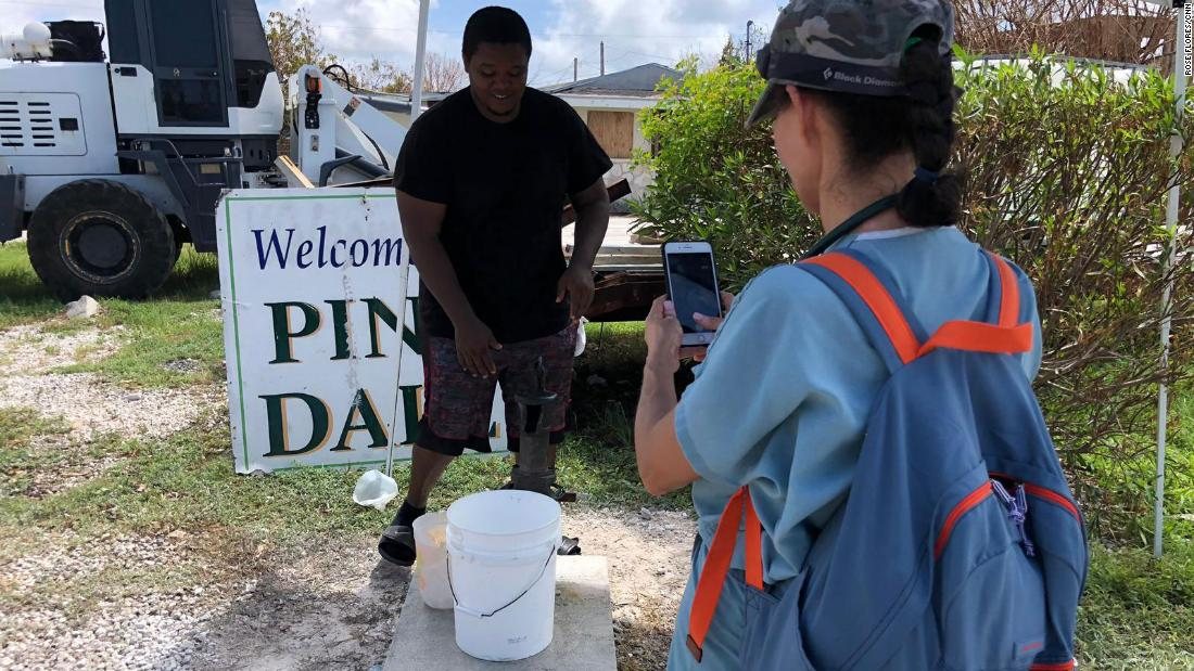 Medic Andrea Krasniansky speaks with a resident on Grand Bahama Island. He said the local well water is no longer safe for drinking because it's contaminated.