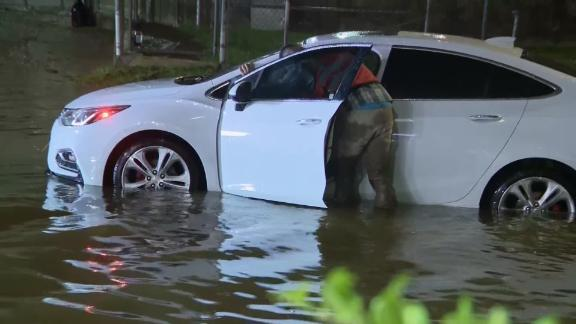 A stalled car sits on a flooded road near Houston's William P. Hobby Airport early Wednesday.
