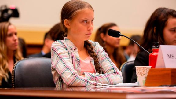 Swedish environment activist Greta Thunberg looks on during a joint hearing before the House Foreign Affairs Committee, Europe, Eurasia, Energy and the Environment Subcommittee, and the House Select Committee on the Climate Crisis, at the Rayburn House Office Building on Capitol Hill in Washington, DC, on September 18, 2019. (Photo by Alastair Pike / AFP)        (Photo credit should read ALASTAIR PIKE/AFP/Getty Images)