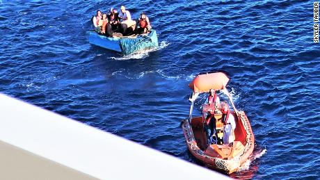 A boat from the Majesty of the Seas towed a stranded boat carrying seven migrants.