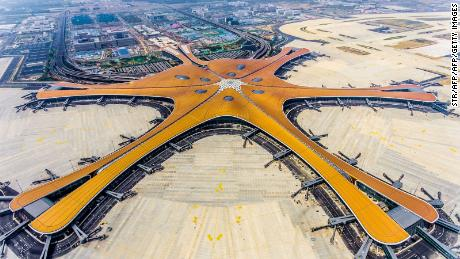 This photo taken on June 28, 2019 shows the terminal of the new Beijing Daxing International Airport. - Beijing is set to open an eye-catching multi-billion dollar airport resembling a massive shining starfish, to accommodate soaring air traffic in China and celebrate the Communist government's 70th anniversary in power. (Photo by STR / AFP) / China OUT / To go with China-Aviation, Focus by Patrick Baert        (Photo credit should read STR/AFP/Getty Images)