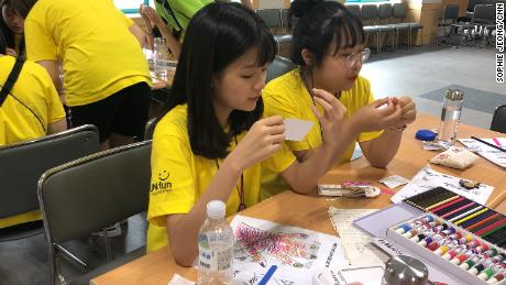 Campers decorate their nails at a government-sponsored smartphone addiction camp in Cheonan, South Korea in July, 2019.