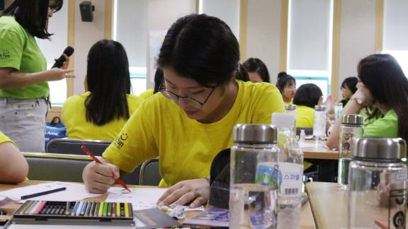 16-year-old Yoo Chae-rin draws nail designs on paper as part of an alternative activity to using smartphone at a government-sponsored smartphone addiction camp in Cheonan, South Korea on July 29, 2019.