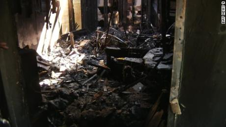 Thanks to their dog's barking, a family was able to escape before fire destroyed their home.