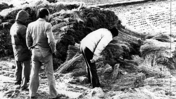 Investigators in July 1987 examine the scene in Hwaseong, south of Seoul, where a woman was raped and brutally killed.
