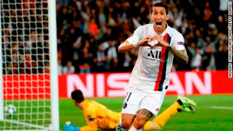 Paris Saint-Germain's Argentine midfielder Angel Di Maria celebrates scoring his team's first goal.