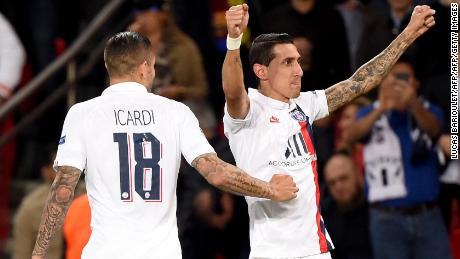 Paris Saint-Germain's Argentine midfielder Angel Di Maria (R) celebrates scoring his team's second goal.