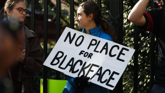 """Protestors rally against Virginia Governor Ralph Northam outside of the governors mansion in downtown Richmond, Virginia on February 4, 2019. - Demonstrators are calling for the resignation of Virginia Governor Ralph Northam, after a photo of two people, one dressed as a Klu Klux Klan member and a person in blackface were discovered on his personal page of his college yearbook. Northam said that while he had not appeared in the photo, """"many actions that we rightfully recognize as abhorrent today were commonplace"""" and he was not surprised such material made its way to the yearbook. (Photo by Logan Cyrus / AFP)        (Photo credit should read LOGAN CYRUS/AFP/Getty Images)"""
