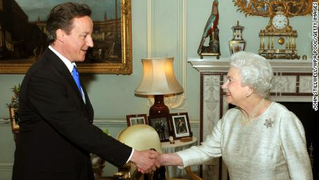 Former British Prime Minister David Cameron pictured with Queen Elizabeth II in 2010.