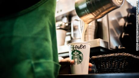 A barista pours steamed milk into a beverage cup marked 'Steven' inside a Starbucks Corp. cafe in the Sandton area of Johannesburg, South Africa, on Monday, Jan. 14, 2019. While South Africa's economy emerged from a recession in the third quarter, growth remains sluggish, hampered by subdued business confidence, higher taxes imposed by the government in February and a tight monetary-policy stance. Photographer: Waldo Swiegers/Bloomberg via Getty Images
