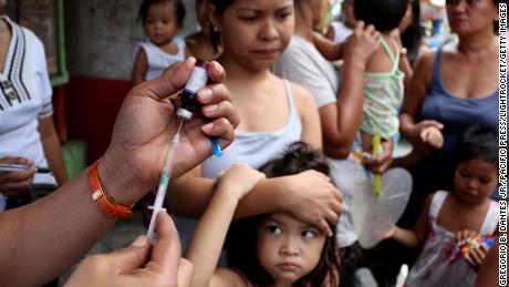 "MANDALUYONG, PHILIPPINES - 2014/09/05: A health worker prepares vaccine. The City Health workers of Mandaluyong City conduct a house to house approach for a free vaccination, during  the celebration of ""Vaccination Month"" to fight against polio and measles. (Photo by Gregorio B. Dantes Jr./Pacific Press/LightRocket via Getty Images)"