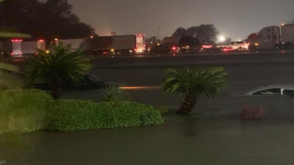 Vehicles were nearly submerged Thursday morning near the Elegante Hotel in Beaumont.
