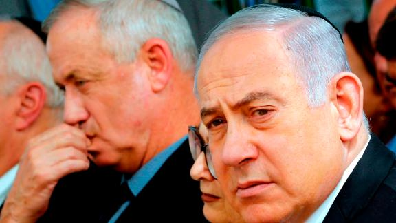 Israeli Prime Minister Benjamin Netanyahu (R), Israeli president of the Supreme Court Esther Hayut (C) and Benny Gantz (L), leader of Blue and White party, attend a memorial ceremony for late Israeli president Shimon Peres.