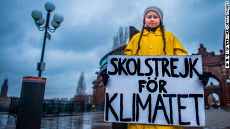 "Greta Thunberg, then 15, holds a placard reading ""School strike for the climate"" during a protest against climate change outside the Swedish parliament last November."