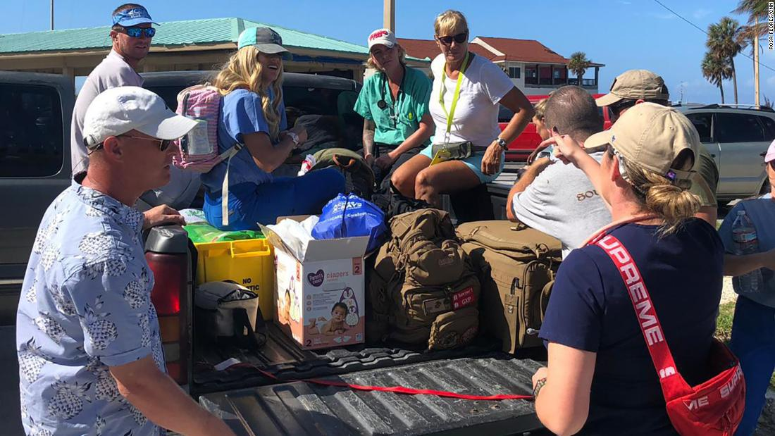 Brittany Reidy, right, debriefs her team in Freeport before heading to East Grand Bahama. (Credit: CNN)