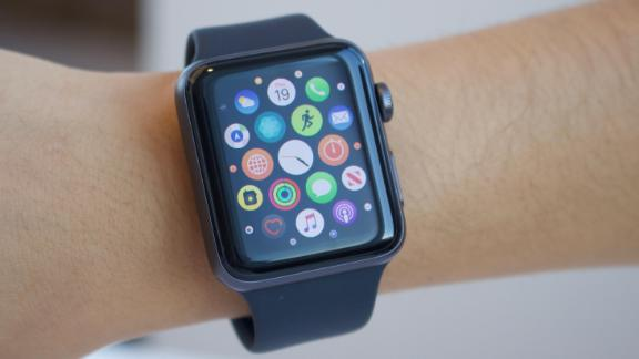 An Apple Watch customer showcases the device