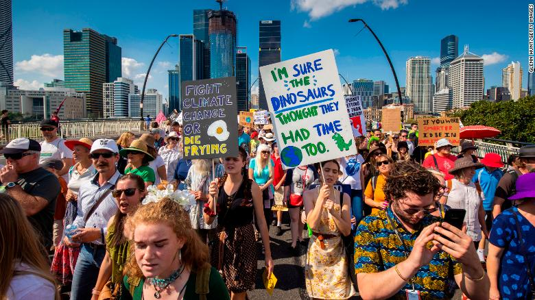 Climate protestors pictured at a rally in Brisbane.