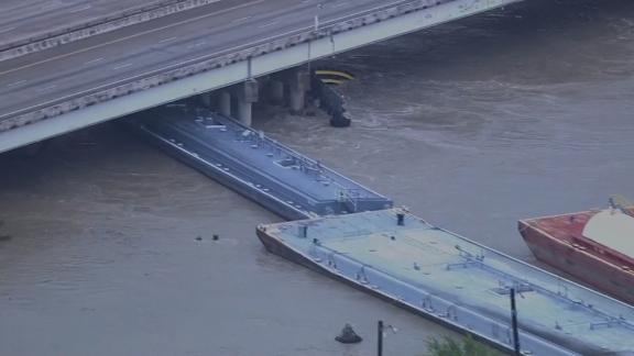 Several barges broke away from a Houston shipyard, striking a bridge, officials said Friday.