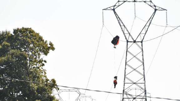 One pilot was caught on a high-voltage electricity line in north-western France before being rescued by emergency services.