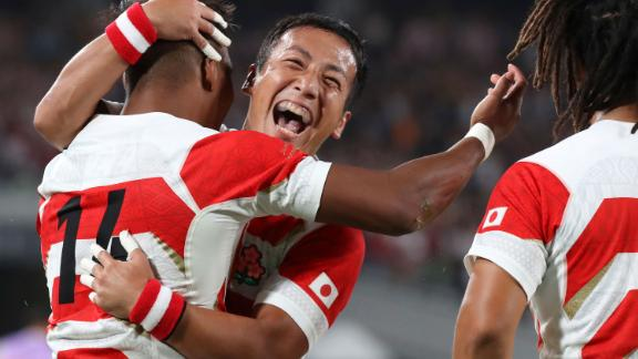 Japan's Matsushima, left, celebrates with Yutaka Nagare, center, after scoring one of his three tries.