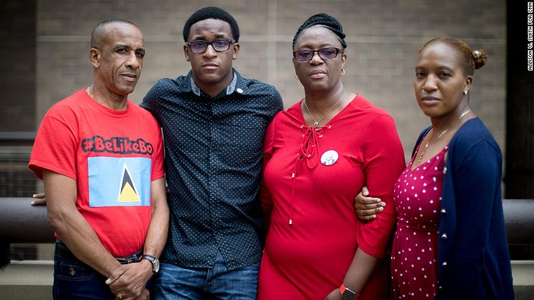 Botham Jean's family (left to right) Bertrum, Brandt, Allison, and Alissa Jean, photographed  outside the Frank Crowley Courthouse in Dallas, Texas.