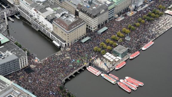 Demonstrators fill the Jungfernstieg, a promenade in Hamburg, Germany.