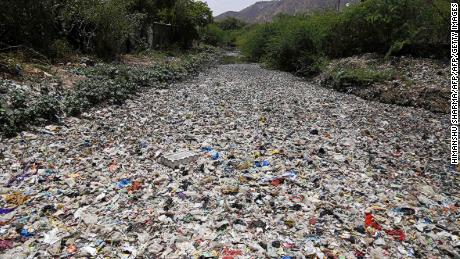 India throws out over 9 million tons of plastic per year. Here, garbage floats along a river in Ajmer, in the Indian state of Rajasthan.
