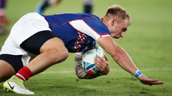 Kirill Golosnitskiy of Russia dives to score his side's first try during the Rugby World Cup.
