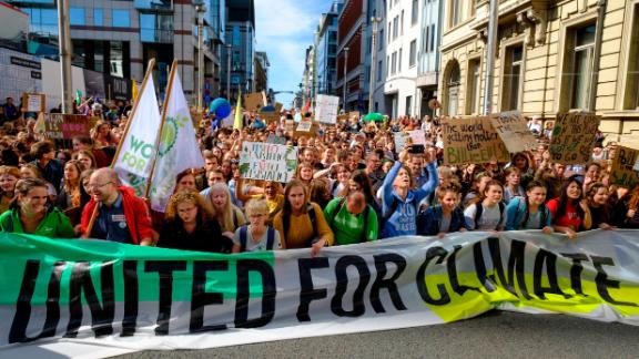 BRUSSELS, BELGIUM - SEPTEMBER 20: Young protesters hold up banners and chant during the third edition of the 'Global Strike For Future' Belgium march to raise awareness for climate change on Friday 20 September 2019 in Brussels, Belgium. Millions of people join protests around the world today to mark the start of a week of global climate strikes, with activists calling on their Governments to urgently address the climate crisis. (Photo by Thierry Monasse/Getty Images)