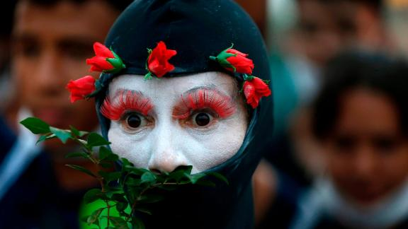A demonstrator representing the Amazon rainforest performs during a protest in Brasilia, Brazil.