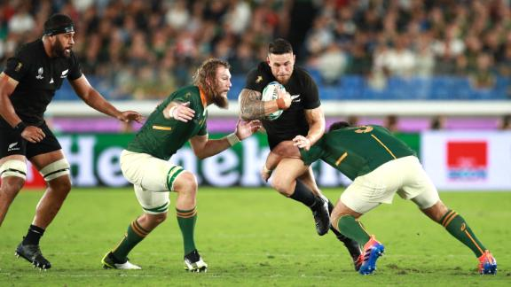 New Zealand has never lost a World Cup group game but were made to work for their 23-13 win by South Africa.