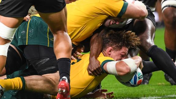 """Australia's flanker Michael Hooper scores a first-half try for the Wallabies. """"We know them very well, their players and that's what we expected,"""" said Australia coach Michael Cheika. """"Probably didn't expect to be as far behind!"""" he added."""
