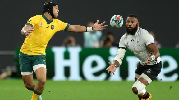 Waisea Nayacalevu (R) of Fiji beats Christian Lealifano to the ball to score a second-half try. However, two tries from Australia hooker Tolu Latu in five minutes ensured the Wallabies avoided a huge upset.