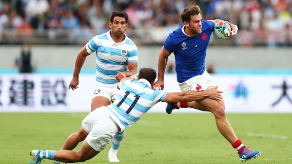 Matias Moroni of France fends off a tackle by Ramiro Moyano of Argentina. The Pumas had a chance to win the game but Emiliano Boffelli was unable to put over a last-minute penalty.