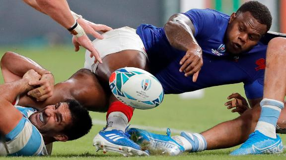France's Virimi Vakatawa looks to pass the ball to a teammate. France led 20-3 at half-time.