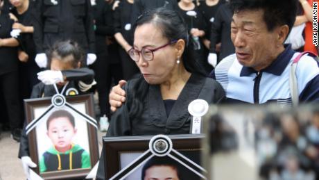 North Korean defectors mourn at a protest in Seoul after the deaths of fellow defectors Han Sung-ok and her son Kim Dong-jin.