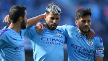 Sergio Aguero (C) celebrates with teammates Bernardo Silva and David Silva after scoring against Watford in an EPL match.