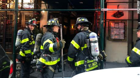 Firefighters respond to a fire near Times Square in Manhattan on Sunday.