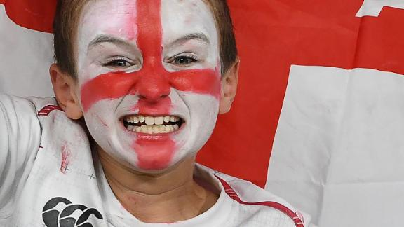 A supporter cheers prior to England