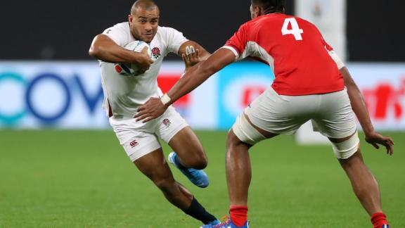 Jonathan Joseph runs past Tonga