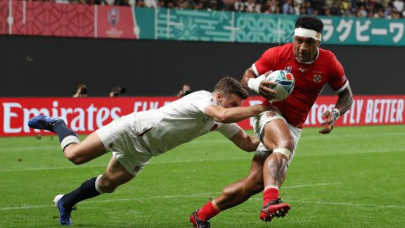 Sonatane Takulua is tackled by England