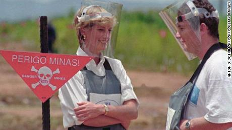 Wearing a heavy duty protection vest and face shield, Princess Diana visits a minefield in Huambo, Angola in 1997.