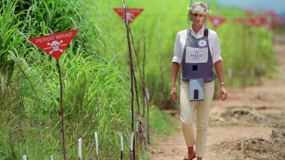 Diana, wearing protective body armour and a visor, visits a minefield being cleared by the charity Halo in Huambo, Angola in 1997.