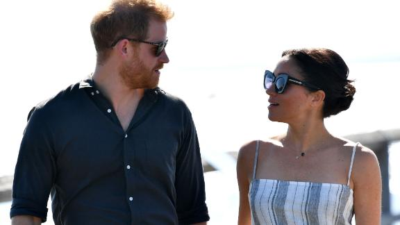 Britain's Prince Harry looks at his wife Meghan, the Duchess of Sussex as they attend a meet-the-people session at Kingfisher Bay Resort on Fraser Island on October 22, 2018. - Prince Harry greeted an Aboriginal community on the stunning World Heritage-listed Fraser Island on October 22 as his pregnant wife Meghan took a break from official duties during the royal couple's Australian tour. (Photo by DARREN ENGLAND / POOL / AFP)        (Photo credit should read DARREN ENGLAND/AFP/Getty Images)