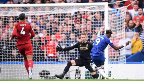 Tammy Abraham has his shot saved by Liverpool goalkeeper Adrian in the first-half.