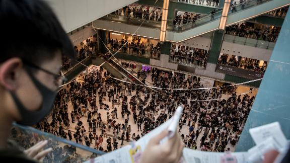 Pro-democracy protesters sing songs and chant slogans during a rally inside a shopping mall on September 22.