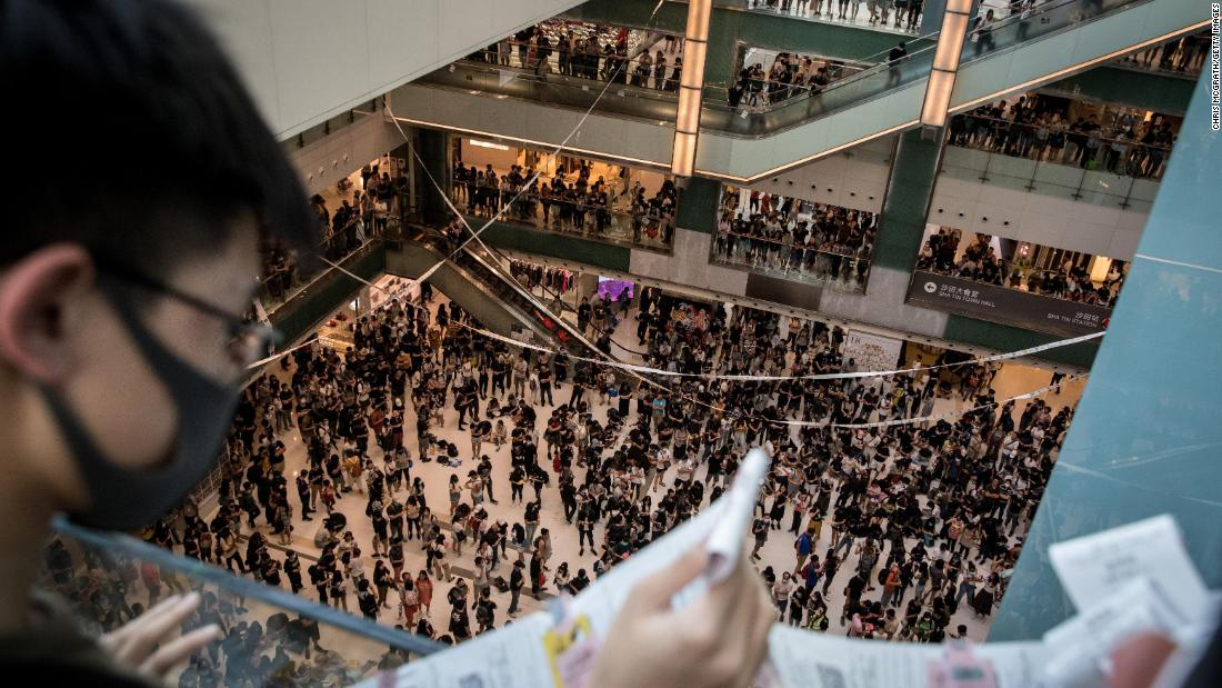 Pro-democracy protesters sing songs and chant slogans during a rally inside a shopping mall in Shatin on September 22.