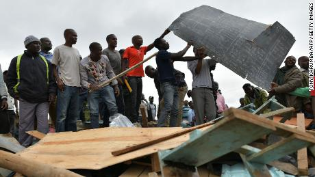 Residents at the site of the collapse