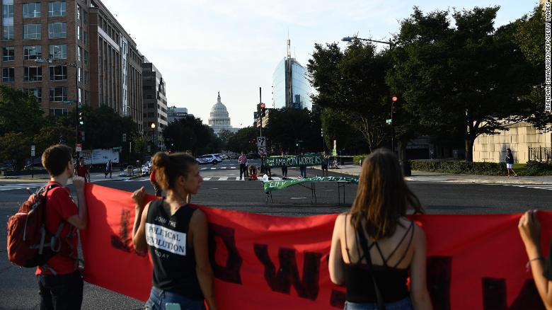 Environmental activists gather to  shut down the US capital on Monday.
